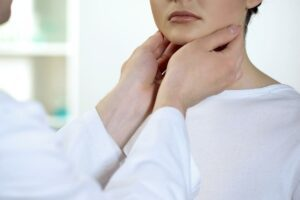 Physician checking patient throat and neck Gateway ENT St Louis MO