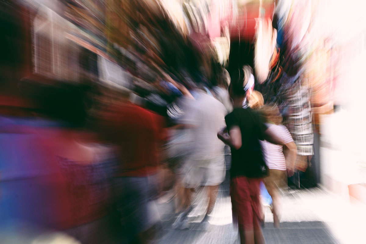 Blurry photo in street, representative of feeling dizzy